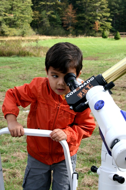 This is what NEFAF is all about! A young astronomer-to-be looks at the Sun through a solar telescope. Credit: Loni Anderson